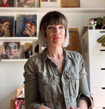 A photograph of Sara Reeve portrait artist in her studio in Brighton
